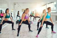 UBER IMAGES - Group of women making squats in gym