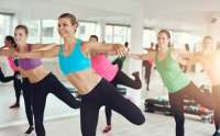UBER IMAGES - Young women working out in aerobics class
