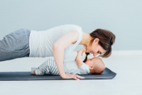 Iryna - young mother does physical yoga exercises together